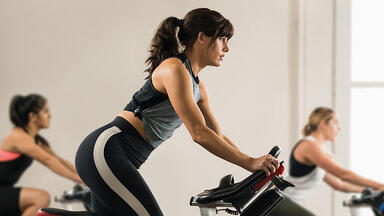 Woman taking a spin class.