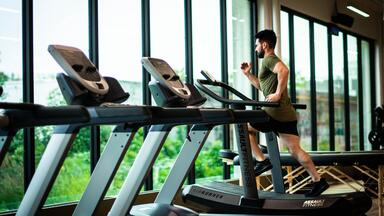 Man running on a treadmill in a health club