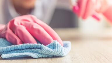 Cleaning with pink gloves on