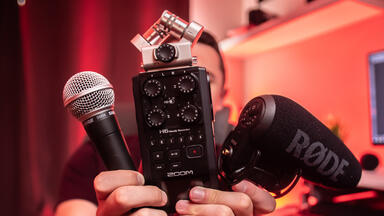Two microphones and an audio mixer