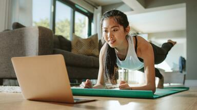 Woman doing an online workout from home