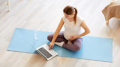 Pregnant woman working out from home virtually