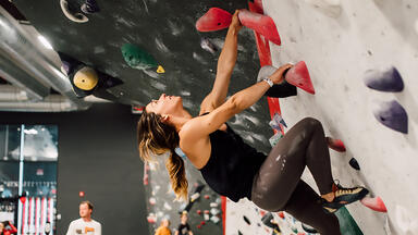 A woman climbing at Threshold Climbing and Fitness