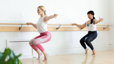 two women doing barre social distancing in studio