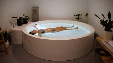 A woman in a float tank at Clear Mind