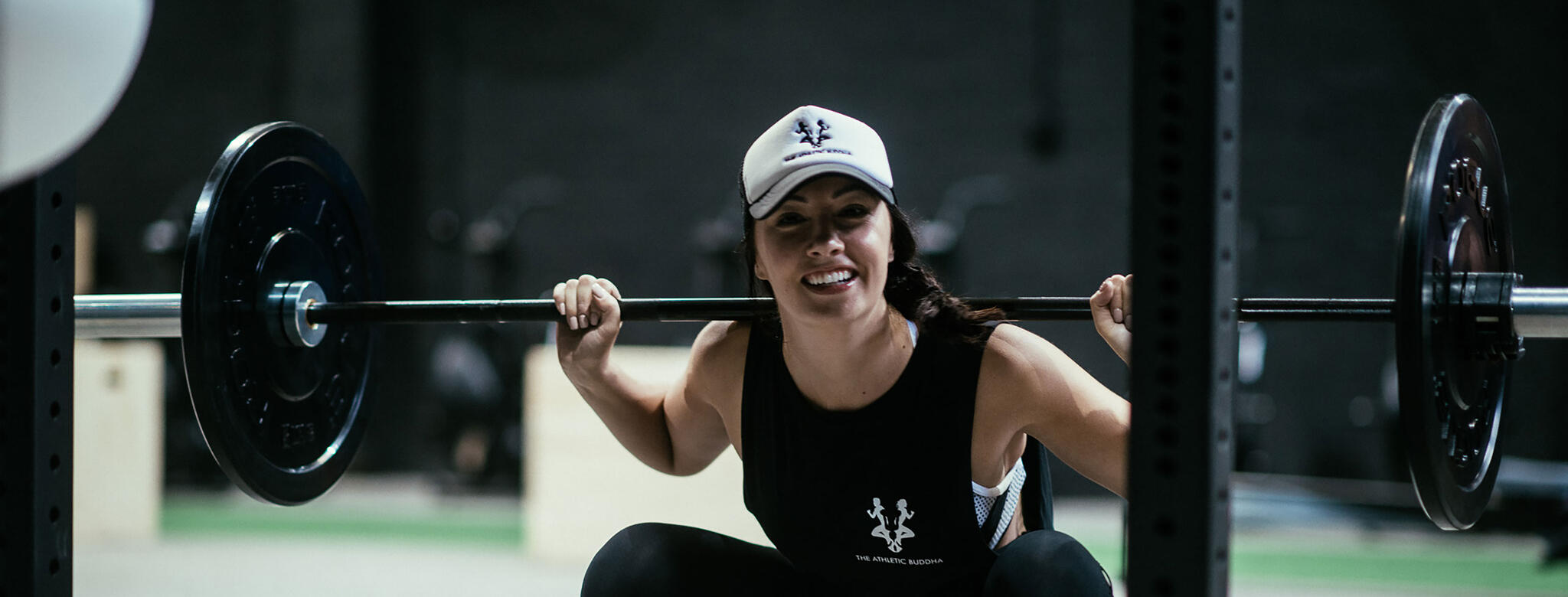 Woman working out at Athletic Buddha