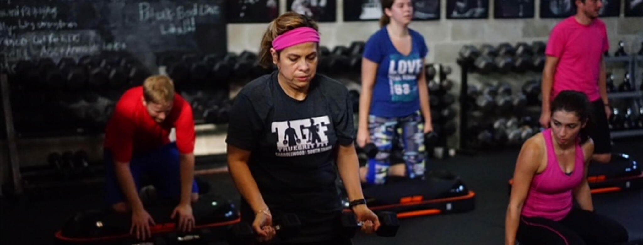 Woman working out at True Grit Fit