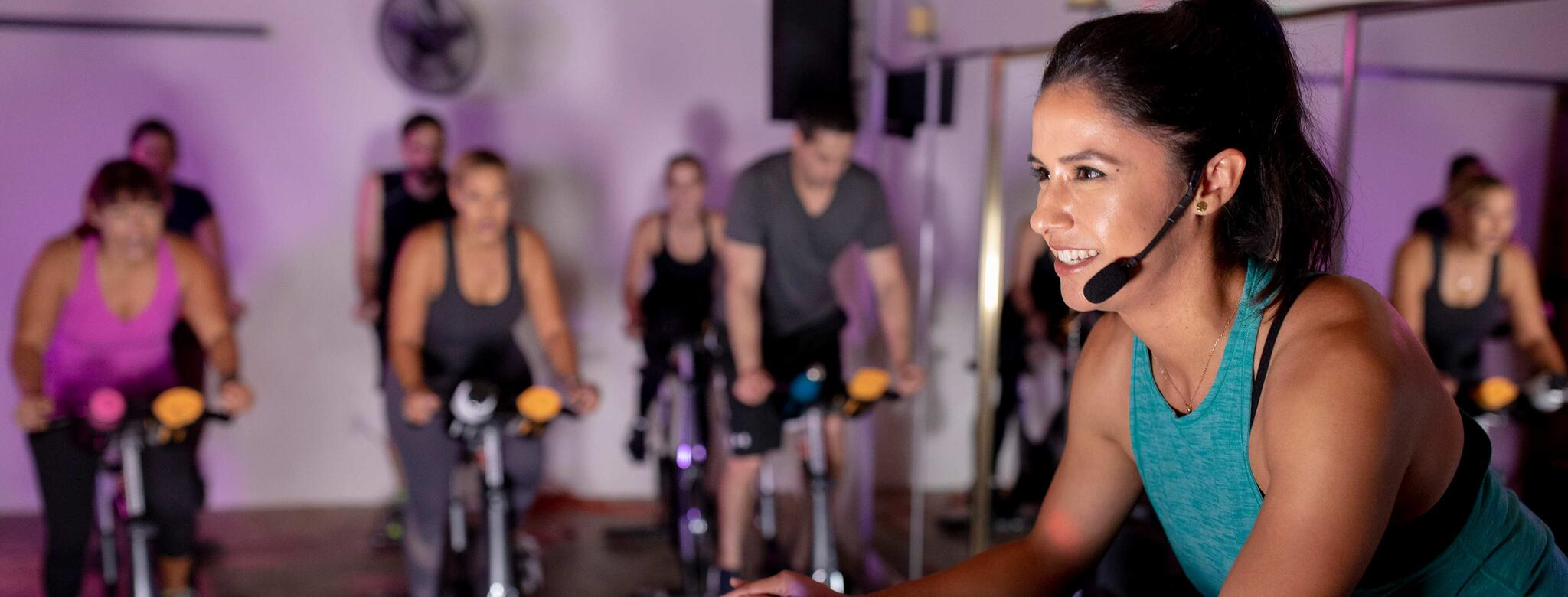 Instructor teaches a cycle class