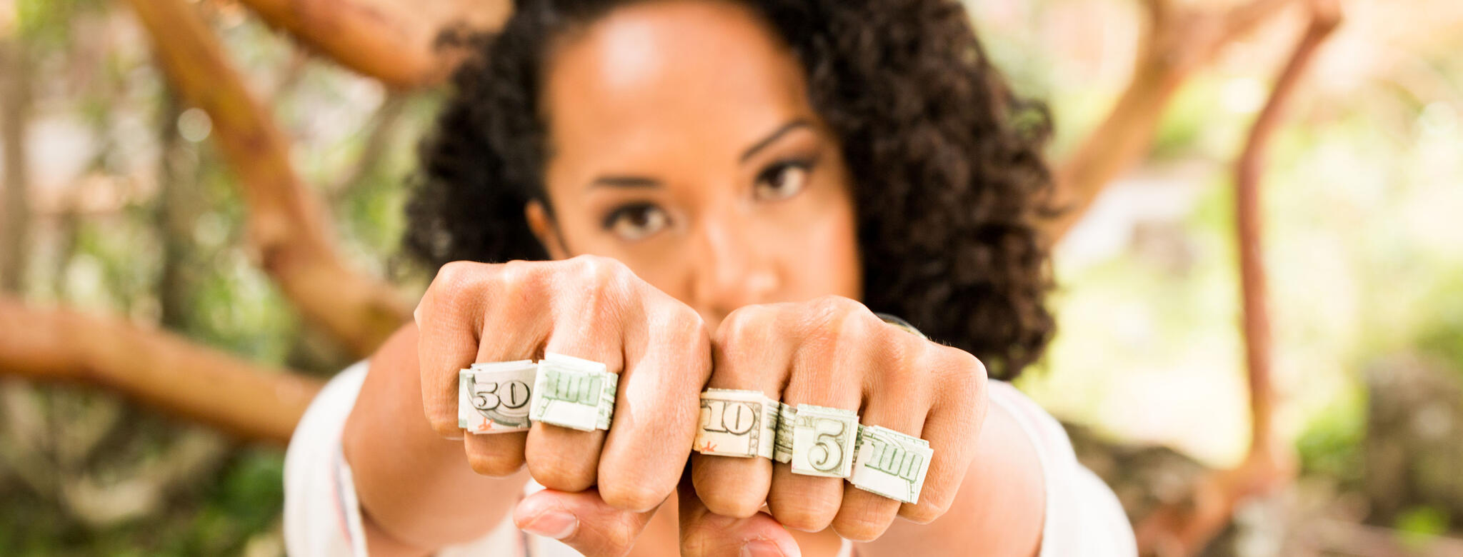 woman in white shirt with rings made of cash