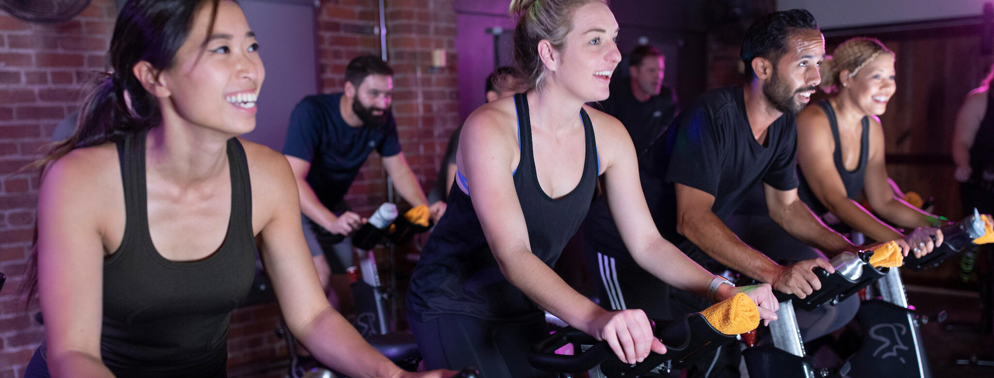 people working out in a cycling class