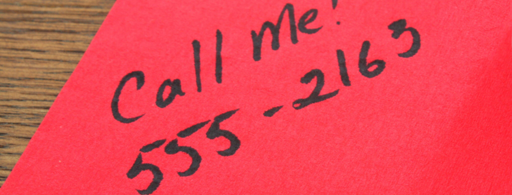 Phone number written on a napkin