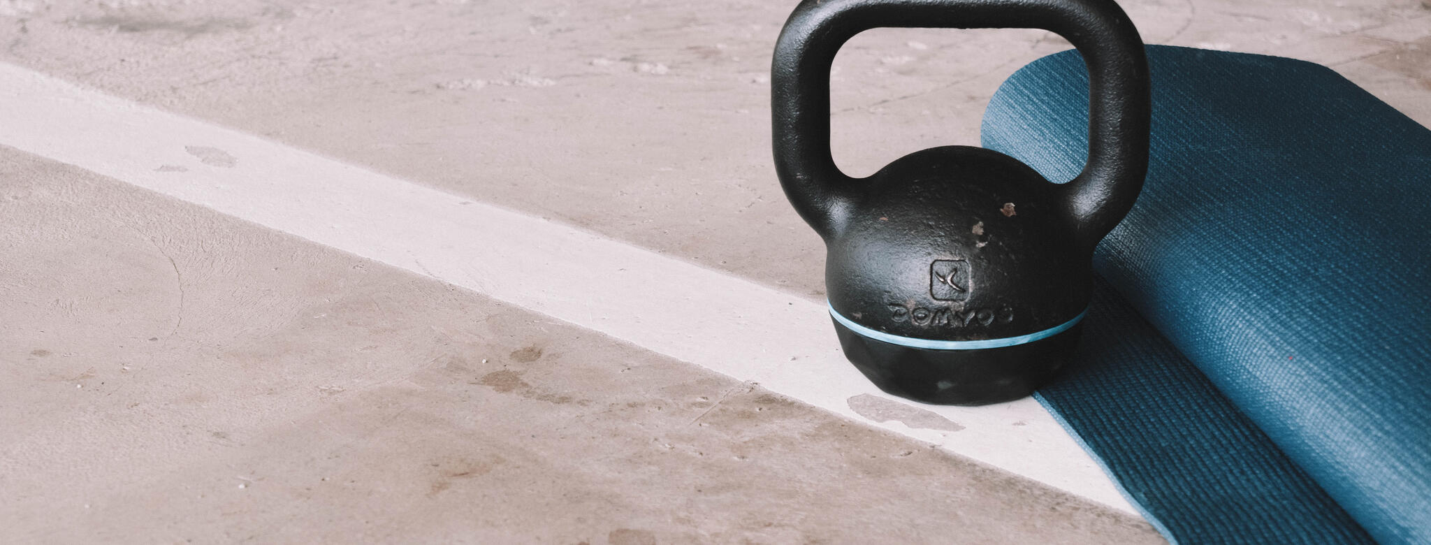 A kettlebell and a yoga mat
