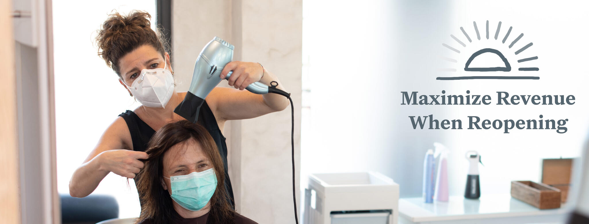 A hair stylist wears a mask while she blow dries a client's hair