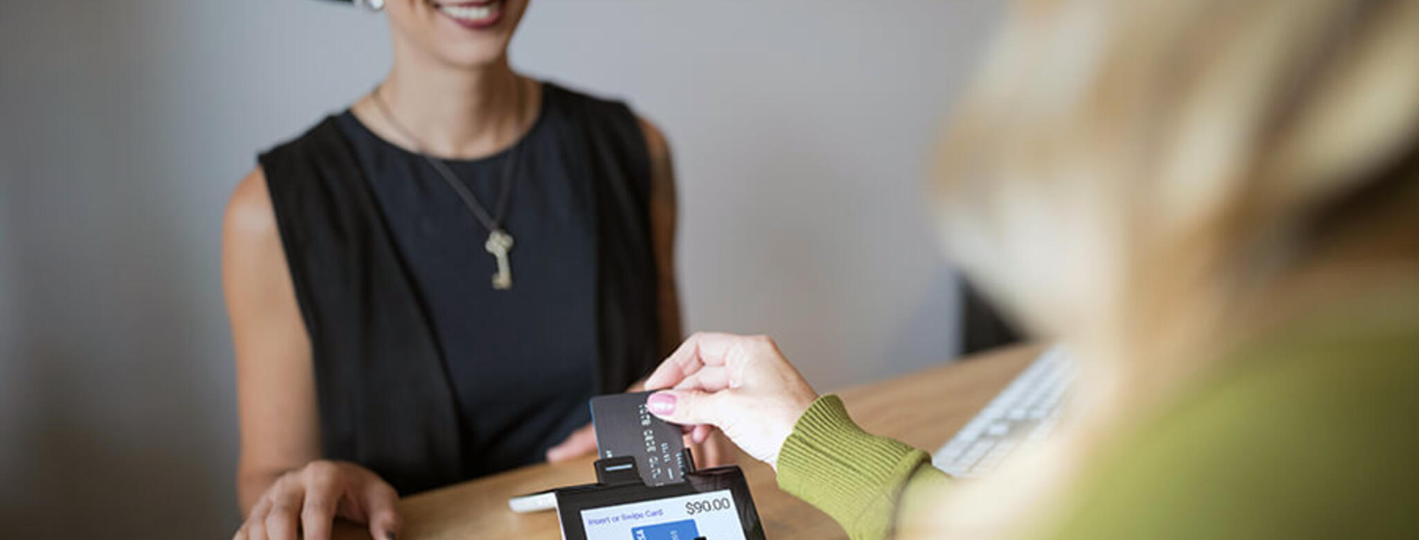 Woman processing payment through Poynt