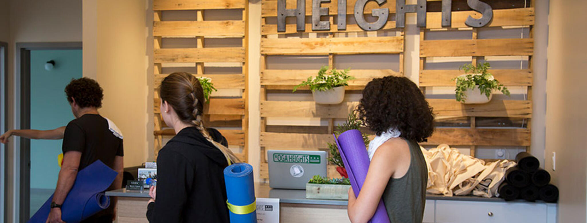 Students checking into class at Yoga Heights