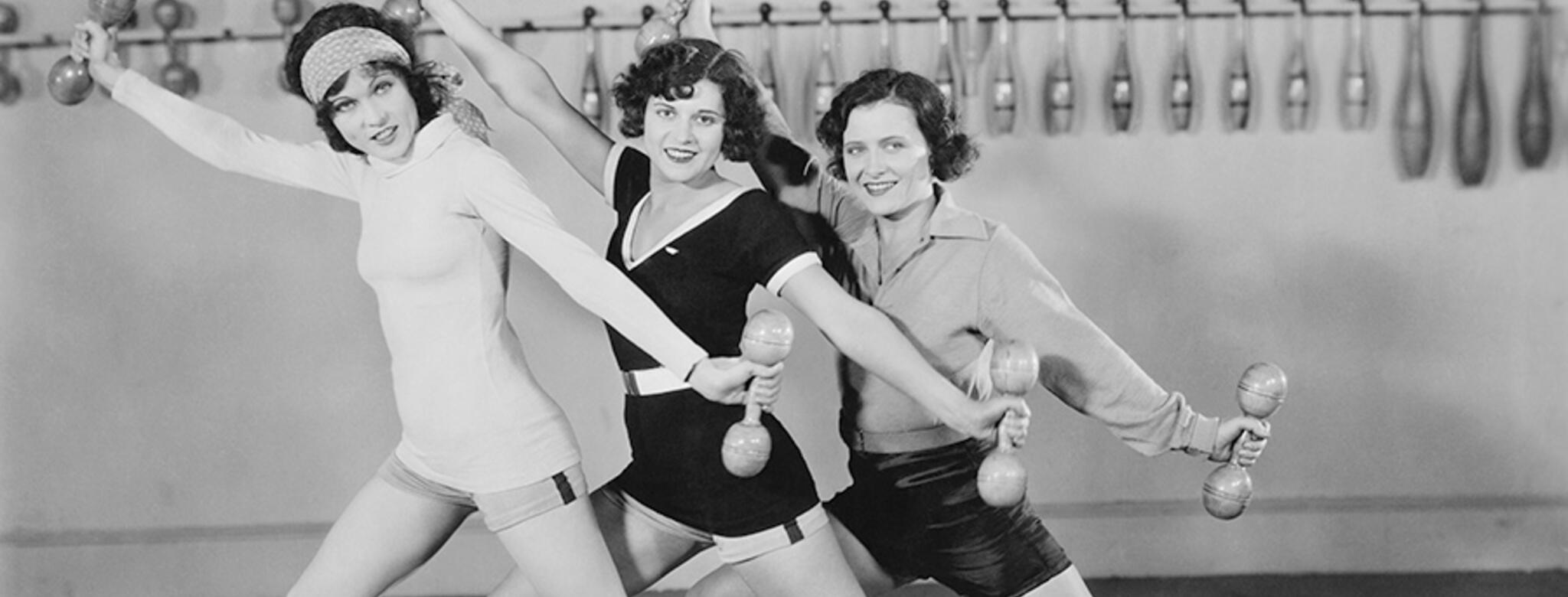 Three woman from the 1920s with vintage workout wear and weights